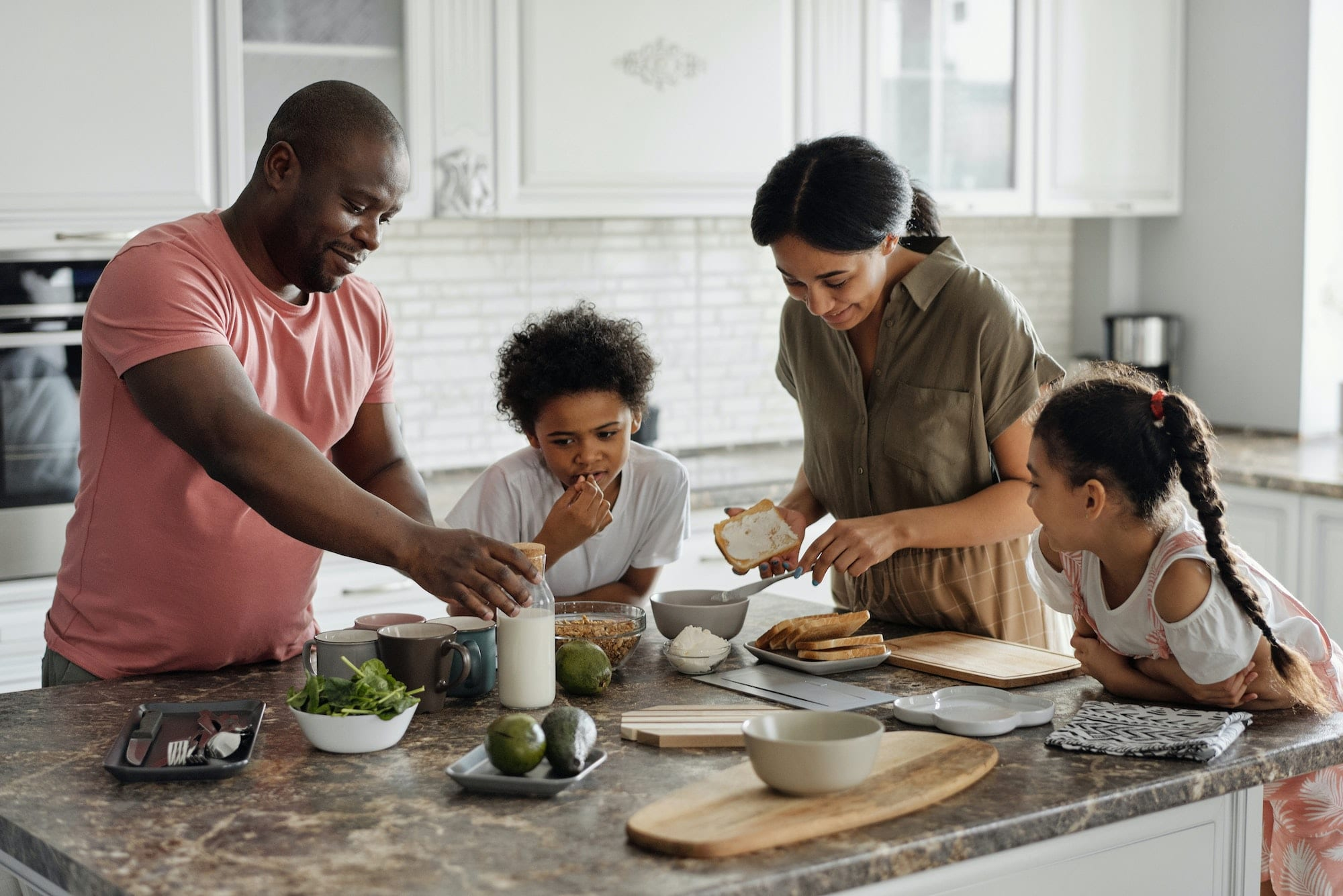 Photo of a family cooking together in a kitchen