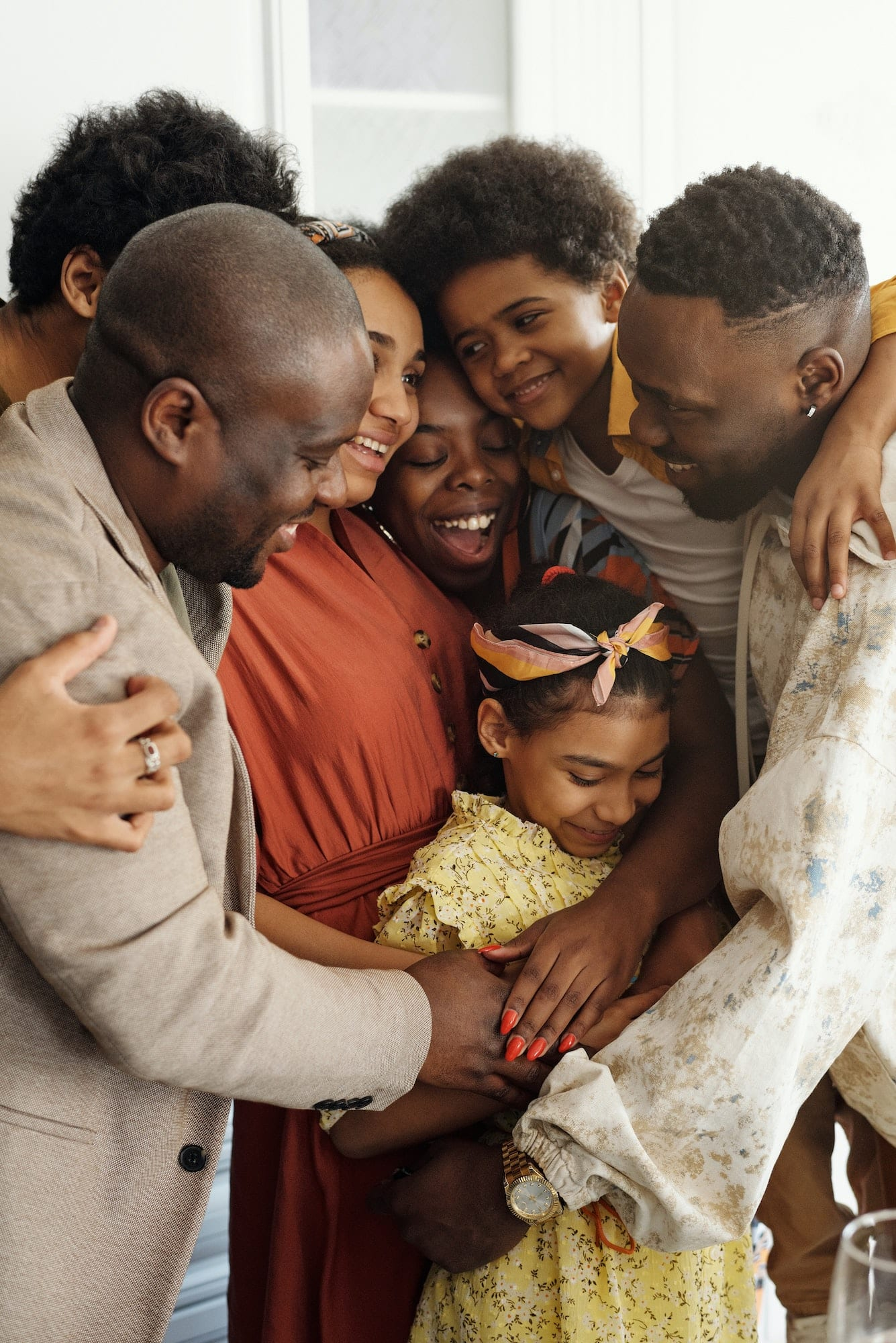 Photo of a family hugging each other