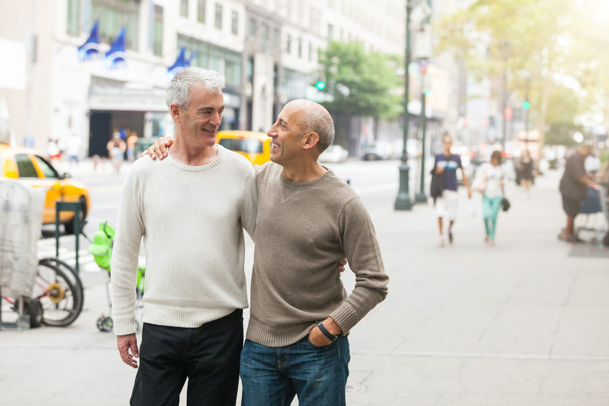 Photo of a gay couple walking in New York
